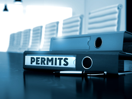 permits: Permits. Illustration on Blurred Background. Folder with Inscription Permits on Office Desktop. 3D Render.