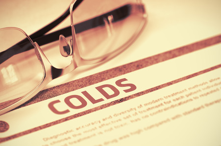 colds: Diagnosis - Colds. Medicine Concept on Red Background with Blurred Text and Pair of Spectacles. Selective Focus. 3D Rendering. Stock Photo