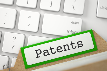 patents: Patents written on Green Card Index on Background of Modern Keyboard. Closeup View. Selective Focus. 3D Rendering. Stock Photo