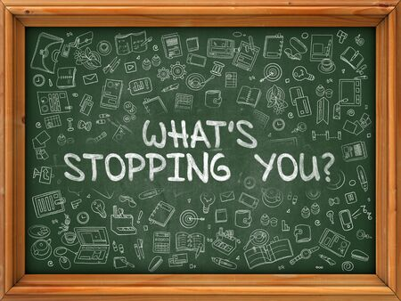 stopping: Whats Stopping You - Hand Drawn on Chalkboard. Whats Stopping You with Doodle Icons Around. Stock Photo