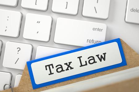 tax law: Tax Law. Orange Folder Register on Background of Modern Laptop Keyboard. Business Concept. Closeup View. Blurred Illustration. 3D Rendering.