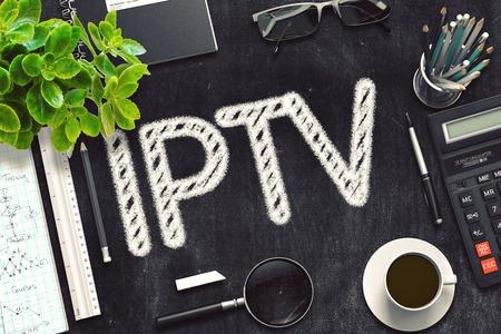 IPTV Handwritten on Black Chalkboard. 3d Rendering. Toned Illustration. Stock Photo
