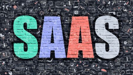 saas: Multicolor Concept - SAAS - Software as a Service - on Dark Brick Wall with Doodle Icons Around. Modern Illustration in Doodle Design Style. SAAS Business Concept. SAAS on Dark Brick Wall. Stock Photo
