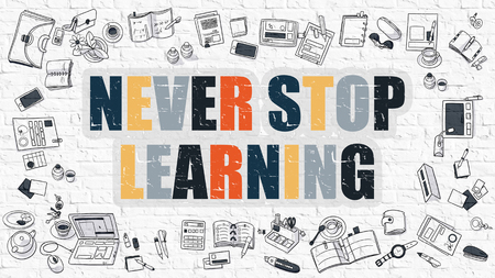 renewed: Never Stop Learning. Never Stop Learning Drawn on White Brick Wall. Never Stop Learning in Multicolor. Modern Style Illustration. Doodle Design Style of Never Stop Learning. Line Style Illustration. Stock Photo