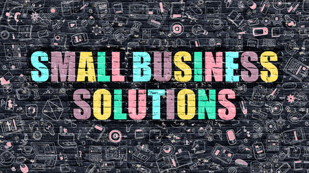 small business: Small Business Solutions. Multicolor Inscription on Dark Brick Wall with Doodle Icons. Small Business Solutions Concept in Modern Style. Small Business Solutions Business Concept.