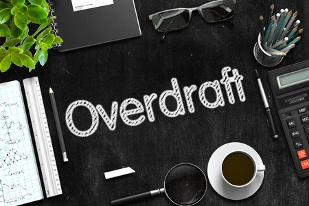 Black Chalkboard With Handwritten Business Concept  Overdraft On Office Desk And Other