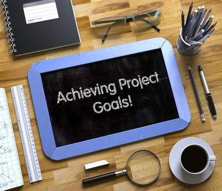 achieving: Achieving Project Goals Handwritten on Small Chalkboard. Small Chalkboard with Achieving Project Goals. 3d Rendering. Stock Photo