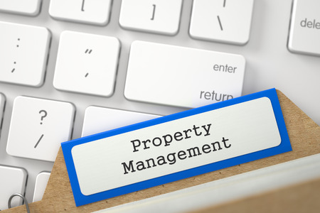 ownership and control: Property Management. Blue Card Index Lays on Modern Keyboard. Archive Concept. Closeup View. Blurred Image. 3D Rendering.