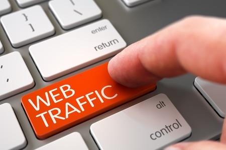 web traffic: Man Finger Pushing Web Traffic Orange Key on Modern Keyboard. 3D Render. Stock Photo