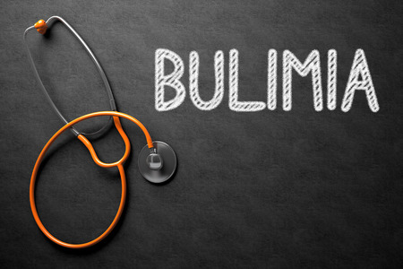 bulimia: Medical Concept: Bulimia - Text on Black Chalkboard with Orange Stethoscope. Medical Concept: Bulimia - Medical Concept on Black Chalkboard. 3D Rendering. Stock Photo