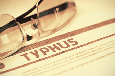 typhus: Typhus - Medicine Concept with Blurred Text and Glasses on Red Background. Selective Focus. Typhus - Medical Concept on Red Background with Blurred Text and Composition of Spectacles. 3D Rendering.