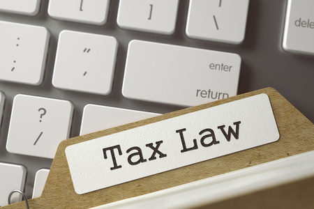 tax law: Tax Law written on  Folder Index on Background of White Modern Keypad. Archive Concept. Closeup View. Selective Focus. Toned Illustration. 3D Rendering.