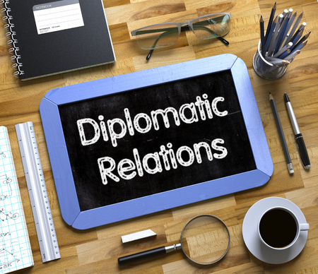 at tact: Diplomatic Relations Concept on Small Chalkboard. Diplomatic Relations - Blue Small Chalkboard with Hand Drawn Text and Stationery on Office Desk. Top View. 3d Rendering.