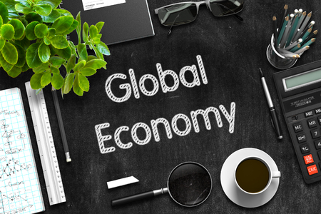 black economy: Global Economy - Black Chalkboard with Hand Drawn Text and Stationery. Top View. 3d Rendering. Stock Photo