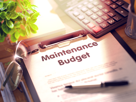 budget repair: Maintenance Budget on Clipboard with Paper Sheet on Table with Office Supplies Around. 3d Rendering. Toned and Blurred Illustration.