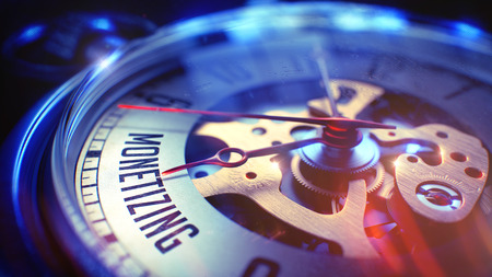 profiting: Monetizing. on Pocket Watch Face with Close Up View of Watch Mechanism. Time Concept. Film Effect. Watch Face with Monetizing Wording on it. Business Concept with Light Leaks Effect. 3D Render. Stock Photo