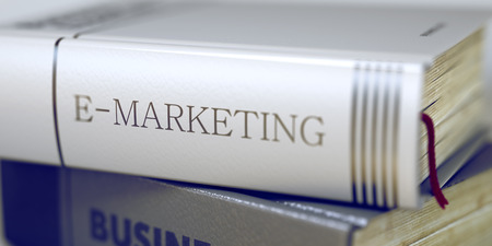 emarketing: Book Title of E-marketing. Book Title on the Spine - E-marketing. E-marketing. Book Title on the Spine. Blurred Image. Selective focus. 3D Illustration.