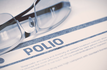 polio: Diagnosis - Polio. Medical Concept on Blue Background with Blurred Text and Pair of Spectacles. Selective Focus. 3D Rendering. Stock Photo