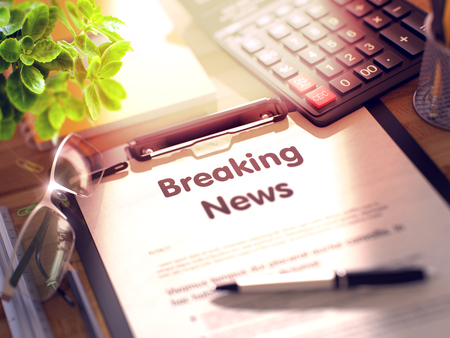 newsflash: Breaking News on Clipboard. Wooden Office Desk with a Lot of Business and Office Supplies on It. 3d Rendering. Toned and Blurred Illustration.