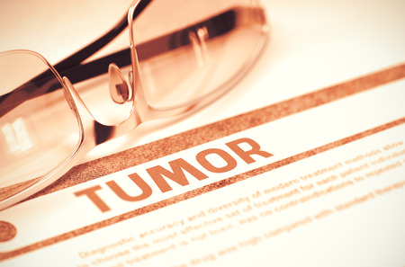 neoplasm: Tumor - Printed Diagnosis with Blurred Text on Red Background with Specs. Medicine Concept. Tumor - Medical Concept on Red Background with Blurred Text and Composition of Eyeglasses. 3D Rendering.