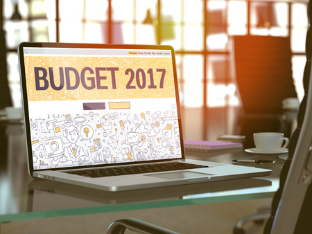 marginal returns: Modern Workplace with Laptop Showing Landing Page in Doodle Design Style with text Budget 2017. Toned Image with Selective Focus. 3D Render. Stock Photo
