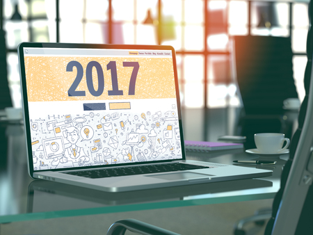 christmas budget: 2017 - Closeup Landing Page in Doodle Design Style on Laptop Screen. On Background of Comfortable Working Place in Modern Office. Toned, Blurred Image. 3D Render. Stock Photo