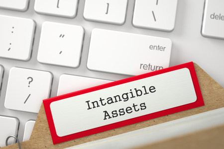 intangible: Intangible Assets written on Red Index Card Lays on White PC Keyboard. Close Up View. Selective Focus. 3D Rendering.