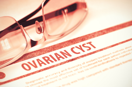 cyst: Ovarian Cyst - Medicine Concept on Red Background with Blurred Text and Composition of Eyeglasses. 3D Rendering.