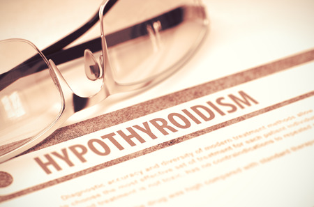 hyperhidrosis: Hypothyroidism - Printed Diagnosis with Blurred Text on Red Background with Specs. Medical Concept. 3D Rendering.