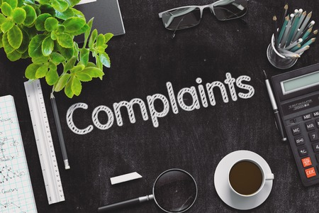 complaints: Complaints Handwritten on Black Chalkboard. 3d Rendering. Toned Image. Stock Photo