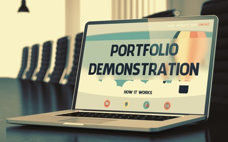 implemented: Portfolio Demonstration Concept. Closeup of Landing Page on Mobile Computer Display in Modern Conference Hall. Toned Image. Selective Focus. 3D Illustration.