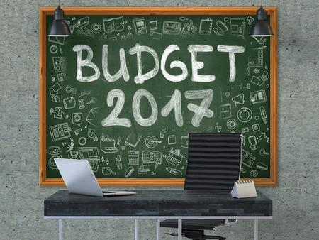 marginal returns: Green Chalkboard on the Gray Concrete Wall in the Interior of a Modern Office with Hand Drawn Budget 2017. Business Concept with Doodle Style Elements. 3D.