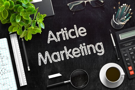 article marketing: Article Marketing Handwritten on Black Chalkboard. 3d Rendering. Toned Image. Stock Photo