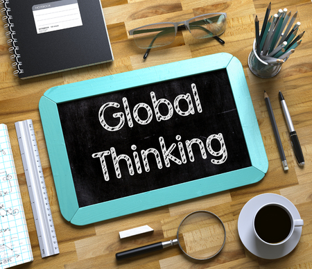 global thinking: Global Thinking - Text on Small Chalkboard.Top View of Office Desk with Stationery and Mint Small Chalkboard with Business Concept - Global Thinking. 3d Rendering.