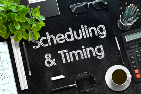 scheduling: Scheduling and Timing Handwritten on Black Chalkboard. Top View Composition with Black Chalkboard with Office Supplies Around. 3d Rendering. Toned Illustration.