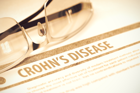 gastroenterologist: Crohns Disease - Medical Concept on Red Background with Blurred Text and Composition of Glasses. 3D Rendering. Stock Photo