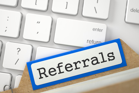 referidos: Referrals. Orange Sort Index Card Lays on Modern Laptop Keyboard. Archive Concept. Closeup View. Blurred Illustration. 3D Rendering.