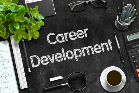 career development: Career Development Handwritten on Black Chalkboard. Top View Composition with Black Chalkboard with Office Supplies Around. 3d Rendering. Stock Photo