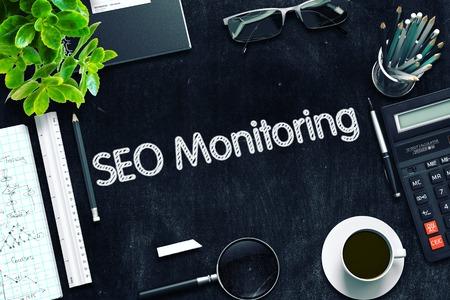 rewriting: SEO Monitoring on Black Chalkboard. 3d Rendering. Toned Illustration.