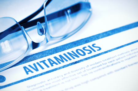 Avitaminosis - Printed Diagnosis with Blurred Text on Blue Background with Eyeglasses. Medicine Concept. 3D Rendering. Stock Photo