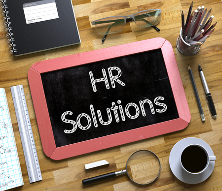 Red Small Chalkboard with Handwritten Business Concept - HR Solutions - on Office Desk and Other Office Supplies Around. Top View. HR Solutions Handwritten on Small Chalkboard. 3d Rendering.