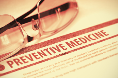 preventive medicine: Preventive Medicine - Printed Diagnosis with Blurred Text on Red Background with Spectacles. Medicine Concept. 3D Rendering. Stock Photo
