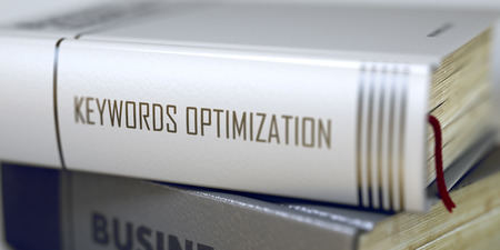 business book: Keywords Optimization - Business Book Title. Book Title on the Spine - Keywords Optimization. Closeup View. Stack of Books. Toned Image with Selective focus. 3D Rendering. Stock Photo