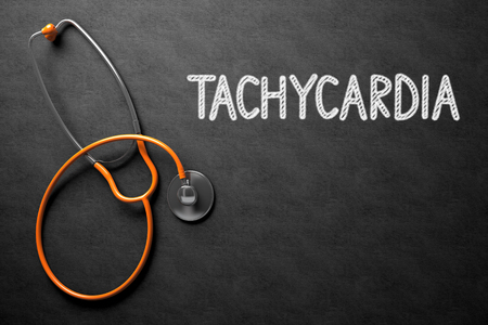 tachycardia: Medical Concept: Top View of Orange Stethoscope on Black Chalkboard with Medical Concept - Tachycardia. Medical Concept: Tachycardia on Black Chalkboard. 3D Rendering.