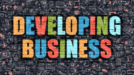 developing: Developing Business Concept. Developing Business Drawn on Dark Wall. Developing Business in Multicolor. Developing Business Concept. Modern Illustration in Doodle Design of Developing Business.
