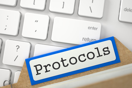 protocols: Protocols. Orange Card Index Lays on Modern Metallic Keyboard. Archive Concept. Closeup View. Blurred Image. 3D Rendering.