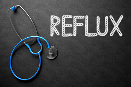 acidity: Medical Concept: Black Chalkboard with Reflux. Medical Concept: Black Chalkboard with Handwritten Medical Concept - Reflux with Blue Stethoscope. Top View. 3D Rendering.