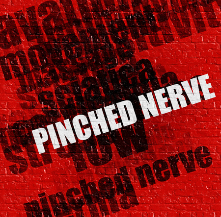 pinched: Healthcare concept: Pinched Nerve on Red Brick Wall .