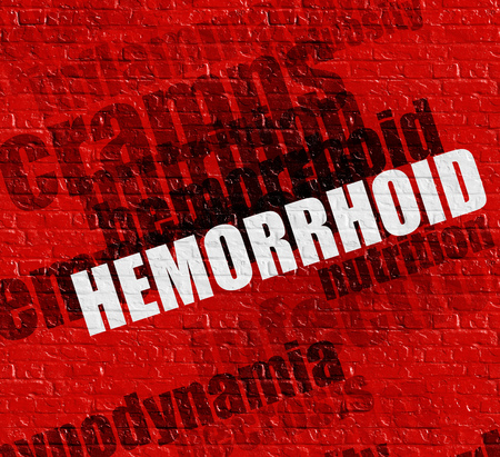rectum: Modern medicine concept: Hemorrhoid - on the Wall with Wordcloud Around . Hemorrhoid on the Red Brick Wall . Stock Photo