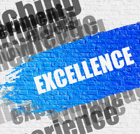 Excellence on the Brickwall. Stock Photo
